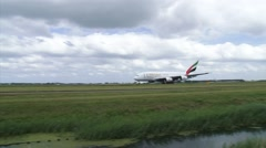 AMS AIRPORT SCHIPHOL Take off airplane Emirates Airbus A380 Polderbaan runway Stock Footage