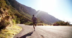 Athlete running outdoors for exercise and fitness Stock Footage