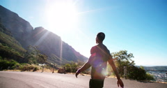 African American runner in sportswear slowing down after training Stock Footage