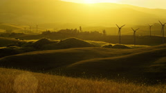Wind Turbines on Countryside Fields at Sunset Time Stock Footage