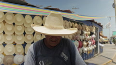 Hispanic Latino Spanish Man At Work, Latino Hat Maker on Street, Smiles 3 - stock footage