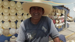 Hispanic Man At Work, Latino Hat Maker on Street Smiles - stock footage
