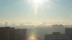 Early morning urban scenic with sun shining over building roofs, skyline Stock Footage