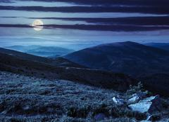 Hillside with stones in high mountains at night Stock Photos