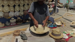 Hispanic Man At Work, Latino Hat Maker on Street 1 - stock footage