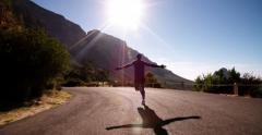Joyful athlete running on a road in the morning - stock footage