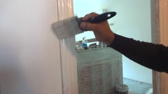 handyman painting a wall - stock footage
