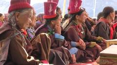 Older ladies with hat watch dance at Silk Route Festival,Sumur,Ladakh,India Stock Footage