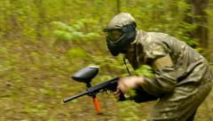 Championship paintball, paintball army soldiers, playing in the woods Stock Footage