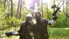 Paintball winners, paintball army soldiers, playing in the woods Stock Footage