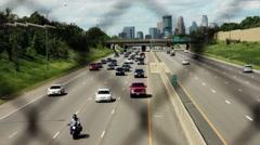 Freeway traffic through fence Stock Footage