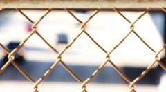 Traffic Thru Fence - stock footage