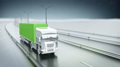 Green cargo truck on a highway. Front view. Looping animation background. Stock Footage