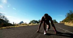 Runner tying his laces and runs of in slow motion Stock Footage