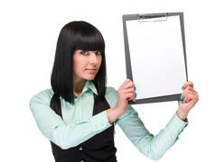 Stock Photo of Happy smiling young business woman showing blank signboard