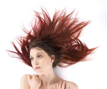 Woman Lying on the Floor with Long Tousled Hair - stock photo