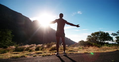 Triumphant African American athlete enjoying fitness in nature Stock Footage