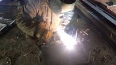 Welder welding metal - stock footage