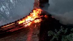 Old house is on fire, and firefighters hose stew. - stock footage