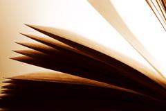 Open old book, pages fluttering. Fantasy, imagination, education - stock photo
