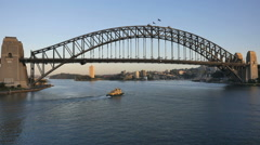 Australia Sydney Harbour Bridge with boat passing underneath Stock Footage