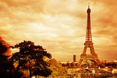 Eiffel Tower in Paris, France. Vintage, retro mood, golden tint. Stock Photos