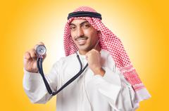 Arab doctor with stethoscope on white Stock Photos