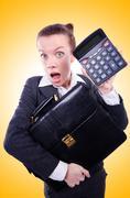 Nerd female accountant with calculator Stock Photos