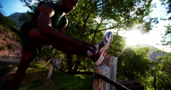 Fit athlete stretching his muscles during an outdoor exercise session Stock Footage