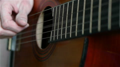 Close up of a man playing an acoustic guitar Stock Footage