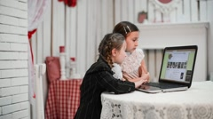 Two astounded girls looking at laptop screen in college Stock Footage