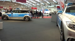 4k BMW police car and Mini Cooper motorshow pan Stock Footage