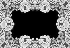Handmade lace doily on a black background - stock photo
