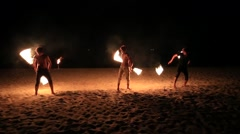Boys performing a dance with fire on the beach in island Koh Kood, Thailand Stock Footage