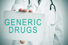Doctor with a signboard with the text generic drugs Stock Photos