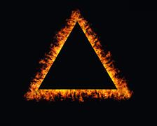 Triangle fire flames frame on black background Stock Photos