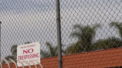 No Trespassing Warning Sign Above Gated Community Stock Footage
