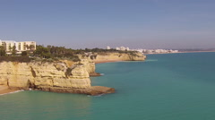Aerial from rocks at the southcoast near Armacao de Pera Portugal Stock Footage