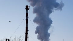 Smoke and steam discharged from an industrial facility - stock footage