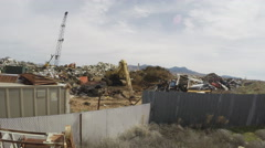 Piles Of Scrap Metal At Recycling Business Zoom- Kingman AZ Stock Footage