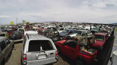 Junked Cars In Desert Salvage Yard Zoom- Kingman Arizona Stock Footage