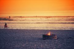 Beach Fire Pit. Oceanside, California Burning Fire Pit on the Beach. - stock photo
