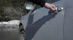 Man tries to open car door Stock Footage