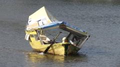 A boat at Sarawak River, Kuching, Malaysia Stock Footage