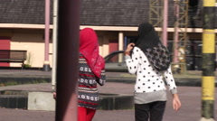 Two muslim women in Kunching, Malaysia Stock Footage