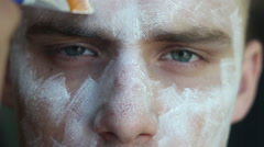 Painting his face in white - stock footage