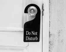 Do not disturb sign hang on door knob - stock photo