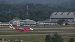 Plane landing at Kuching International Airport Stock Footage