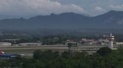 Plane landing at Kuching International Airport Stock Footage