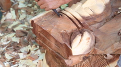 Hand of carver carving wood - stock footage